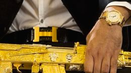 El Chino Antrax pairs his Cartier watch with a matching gold Kalashnikov