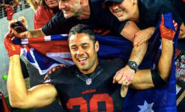 Jarryd Hayne celebrates with Aussie 49ers fans
