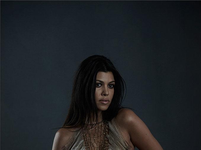 Kourtney Kardashian poses nude and pregnant for DuJour