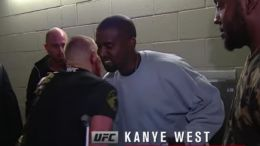 Conor McGregor hugs Kanye West at UFC 202.