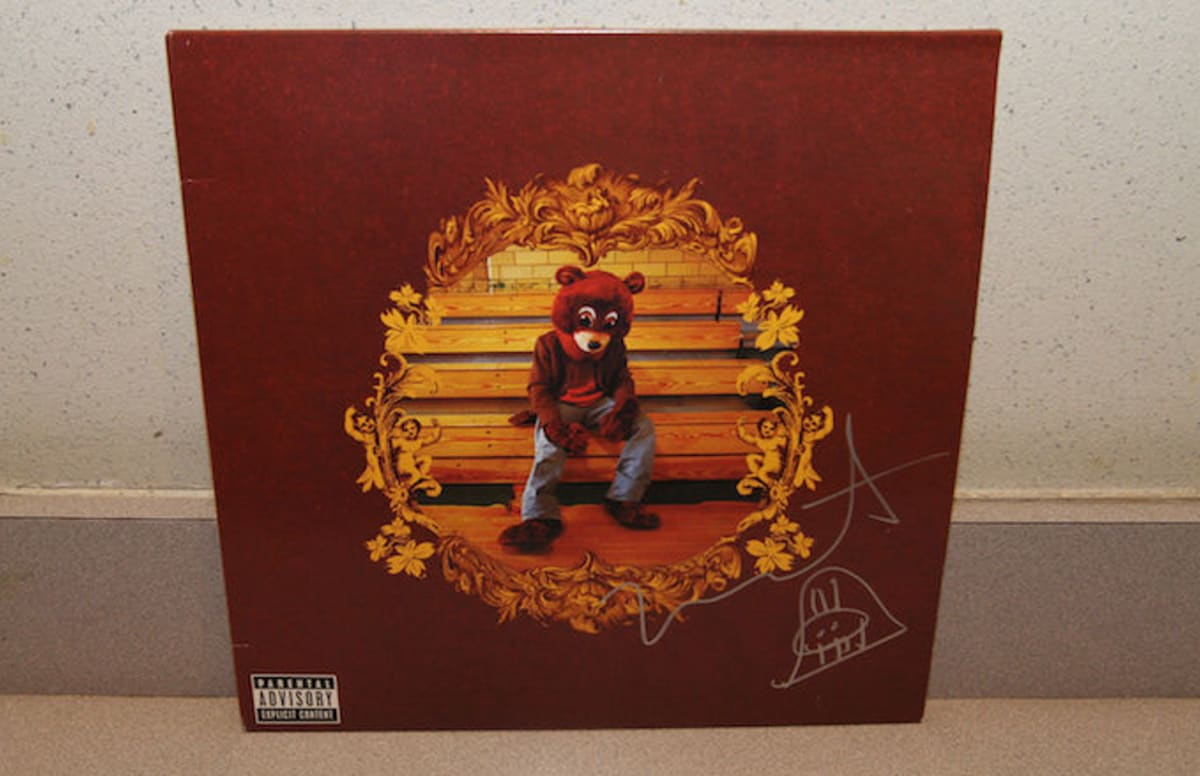 Kanye west signed a college dropout vinyl to auction off for Charity motors auction 8 mile