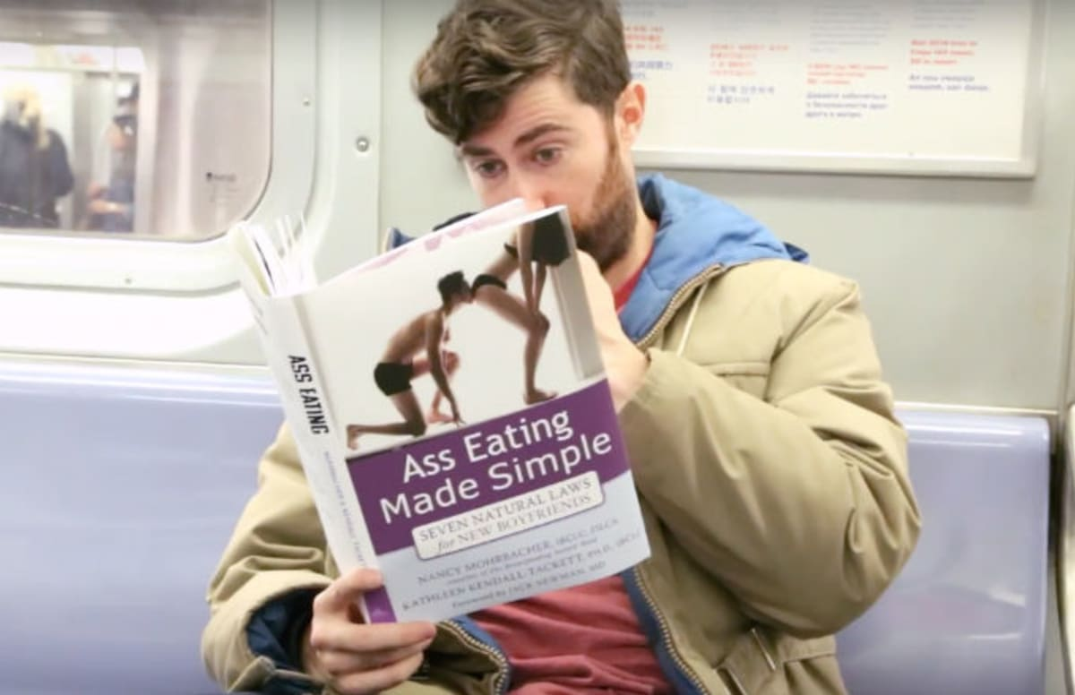 Comedian S Subway Prank Features Him Reading Fake Books