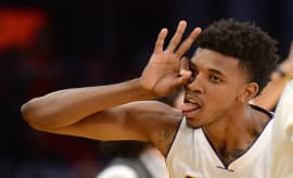 Nick Young celebrates a three-point shot