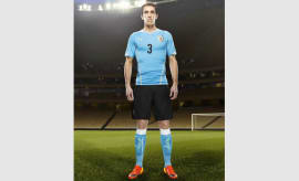 Diego Godín in the 2014 Uruguay Home Kit that features PUMA's PWR ACTV Technology