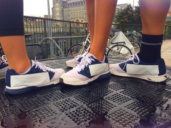 Georgetown student-athletes cover Nike Swoosh on their sneakers