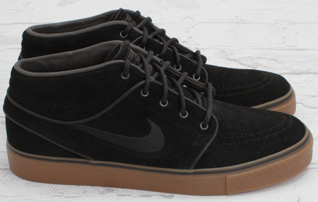pretty nice 5dd27 1fdba Nike SB lets loose another go of its prized Zoom Stefan Janoski model, this  time in mid-cut form. The upper highlights a barrage of black suede with  tonal ...