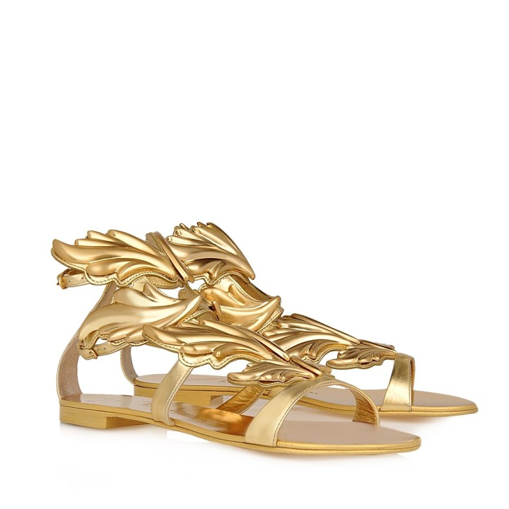 71eec098b0619 While not necessarily designed by Kanye West, these calfskin sandals with  decorative golden leaves are some of the most luxurious sandals of all-time.
