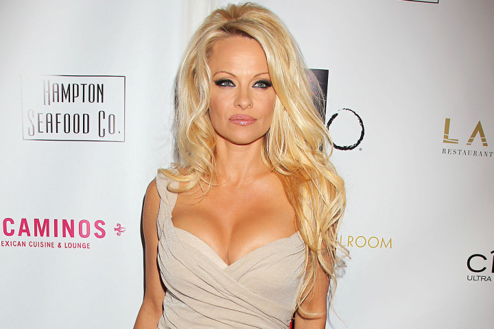 "Playboy model, Pamela Anderson, says she ""never felt that great looking"" and laughs at being a model"
