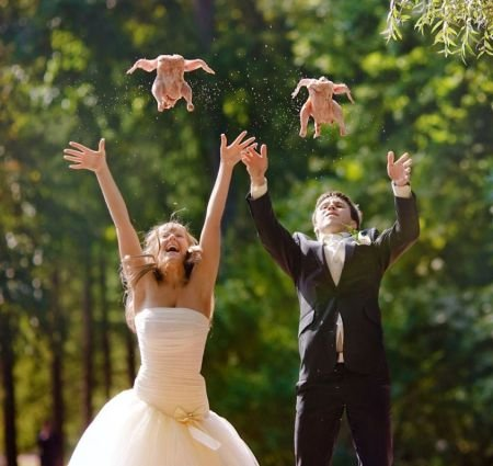 awkward wedding photo of bride and groom throwing chickens