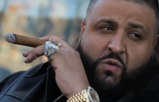 DJ Khaled smoking a cigarette (or weed)