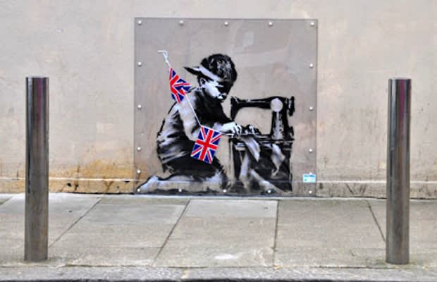 Banksy slave labour mural auctioned for more than 1 1 for Banksy mural sold