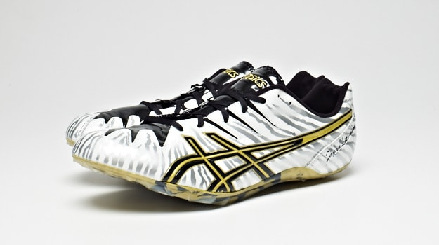 The Asics Japan Lite-Ning 4 Track Spike