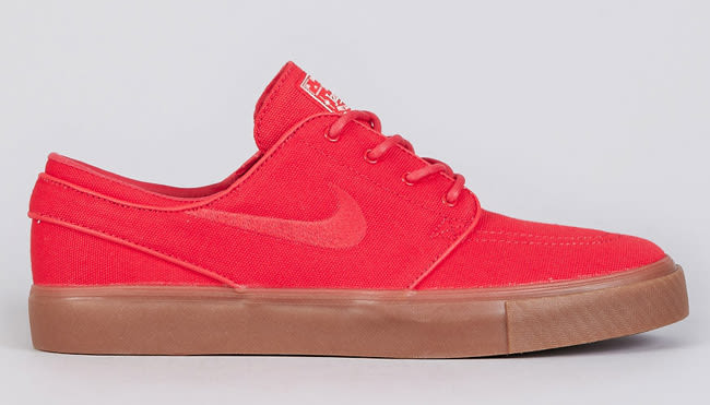 a85700681986 Hyper Red canvas covers this latest colorway release of Nike SB s heralded Zoom  Stefan Janoski