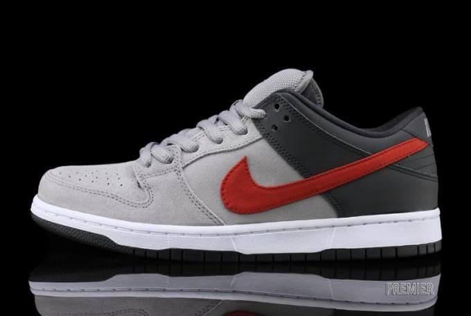 b26c8d6c695 Grey suede and Anthracite-colored leather are showcased on this new Dunk  drop-off from Nike SB. The low-top pro pair is then complemented with red  Swoosh ...