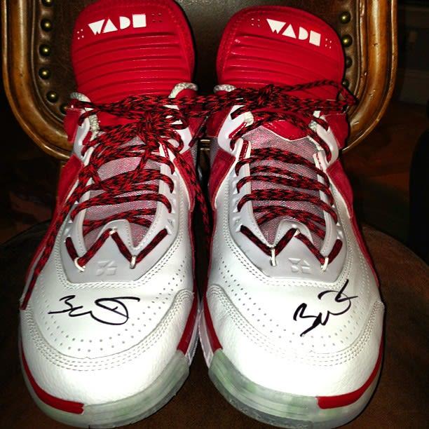 12849e160c3 Rick Ross Flaunts Sneakers Signed by Dwyane Wade