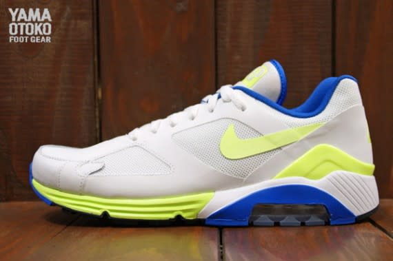 brand new 9aebc 470ab Hot Lime and Blue Sapphire accents captivate on this new Summit White set  of the Air Max Terra 180 from Nike Sportswear. The low-top silhouette has  been ...