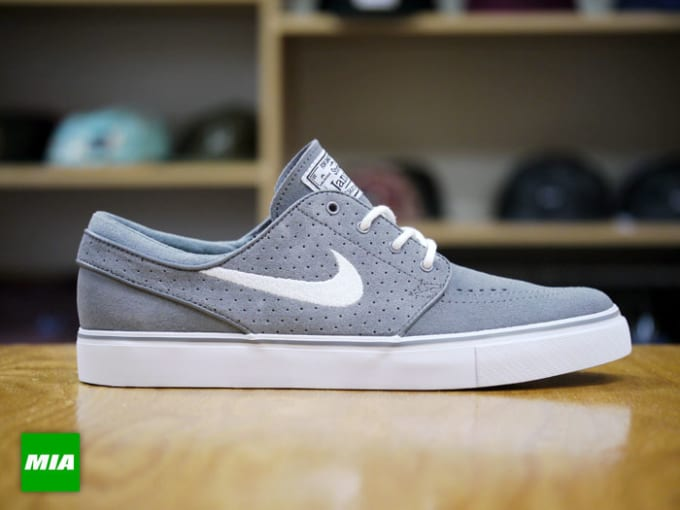 pretty nice 99ec2 a6ca2 Nike SB goes with both perforated suede and smooth suede on this new  colorway release of the popular Zoom Stefan Janoski model. The skate  low-tops note a ...