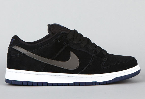 new styles ef7dd bd0c1 ... usa black suede covers the majority of this recent dunk low release  from nike sb as