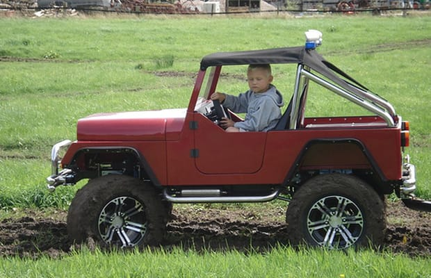 this 12 scale jeep may be for rednecks in training but we still love it chrome wheels and a 4 cylinder gas engine make this junior 4x4 totally legit