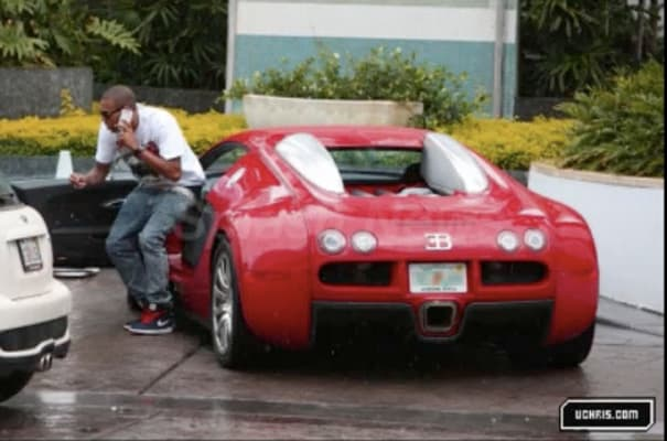 Chris Brown getting out of this Rapid Red Bugatti Veyron ...