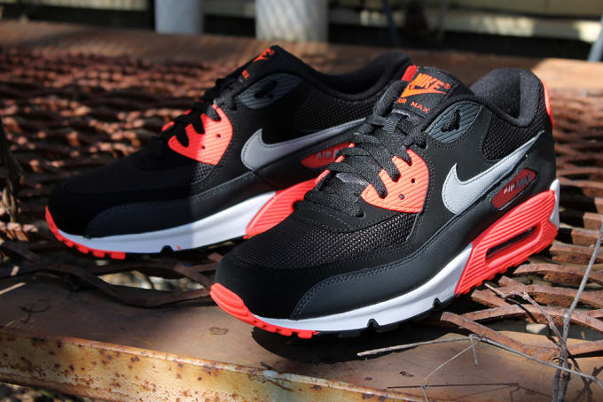 premium selection 2216f 4d701 Atomic Red accents capture attention on this new colorway release of the Air  Max 90 Essential from Nike Sportswear. The body showcases a predominantly  black ...