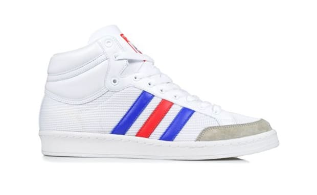 size 40 011ff acb0e adidas Originals presents a new take on its Americana Hi 88 model with a  classic look. The Three Stripes set features leather and canvas upper  construction, ...