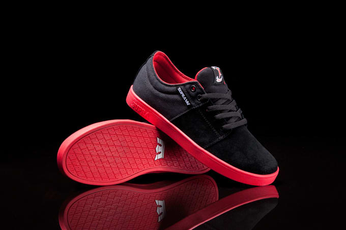 Supra pairs a black upper with a contrasting red midsole on this recent  drop of its Stacks model. Suede and canvas cover the low-top model 615a420b5