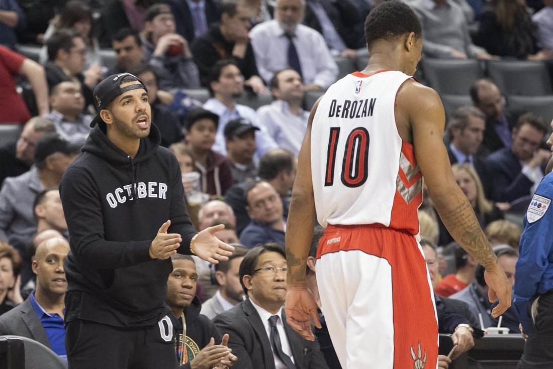 Drake cheers DeMar DeRozan during a game in Toronto. Image via USA TODAY  Sports / Nick Turchiaro