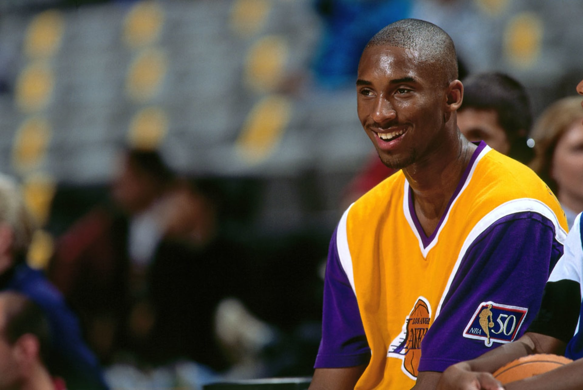 429ab7efe65 Kobe smiling circa 1997 at the Oakland Coliseum. Image via Rocky  Widner NBAE Getty Images.