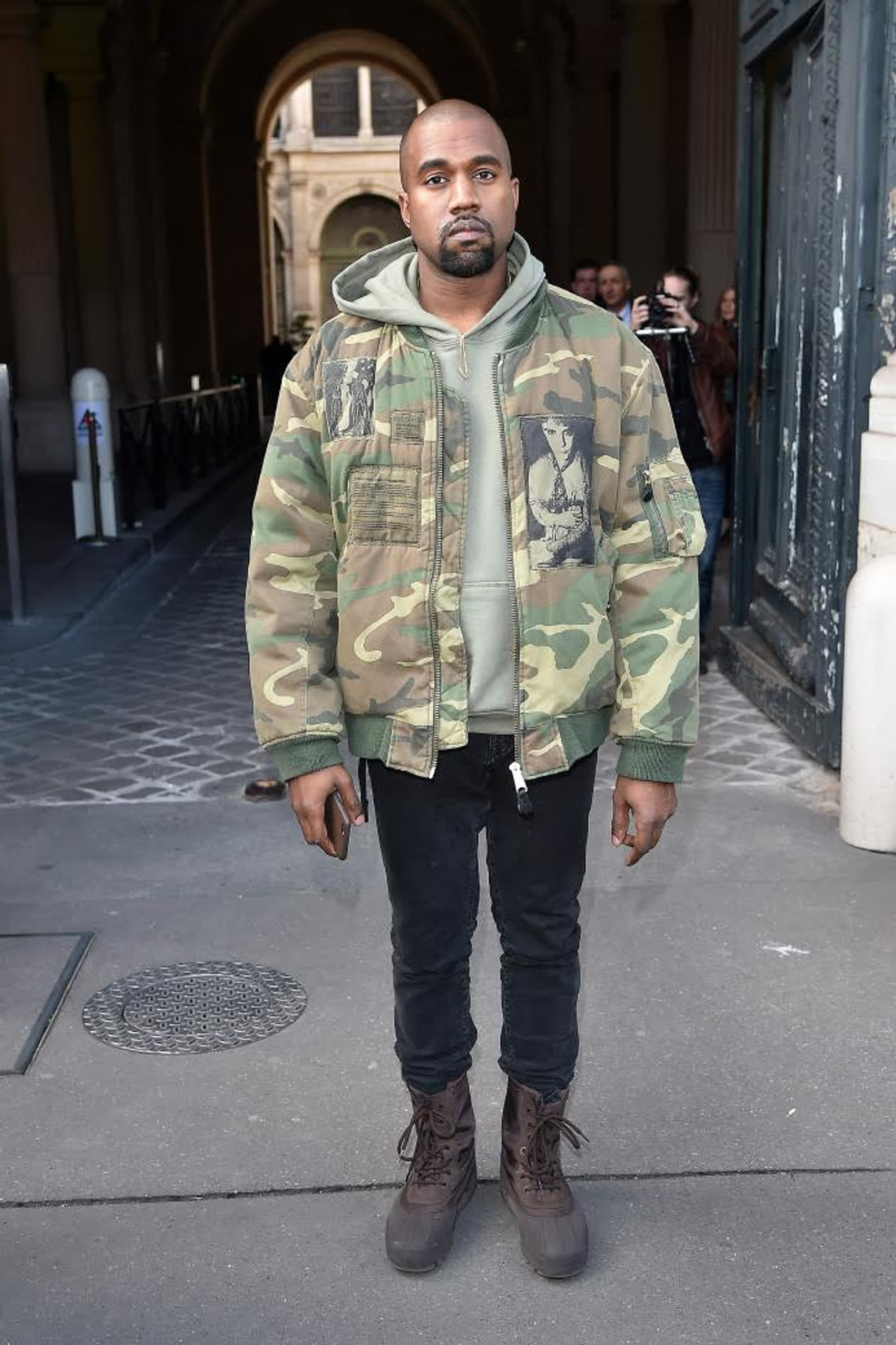 56eee610c31e Kanye West in a Raf Simons bomber from the 2001 Riot collection. Image  Jacopo Raule GC Images