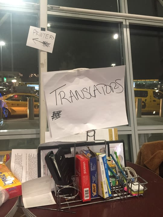 translators sign at jfk