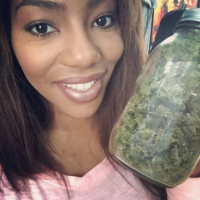 Charlo Greene with a jar of bud