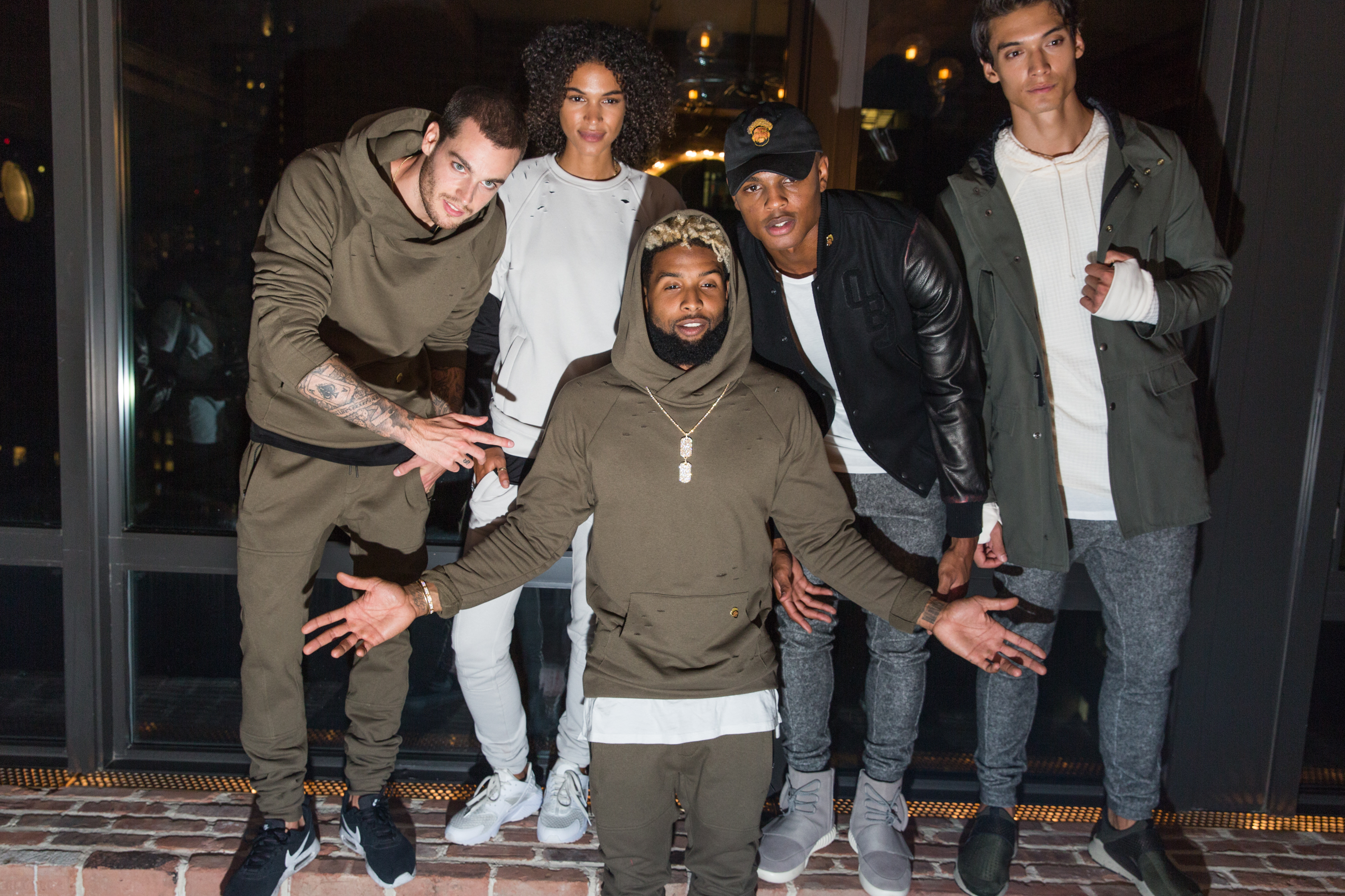 Odell Beckham Jr with models at 13 x twenty launch