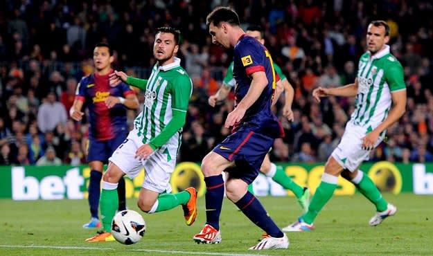 Strikers Lionel Messi