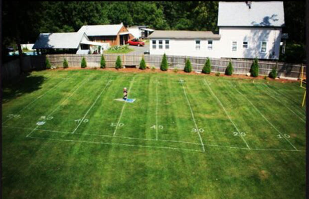 Football Field. If your kids are football fanatics, you'll likely be better off putting only a scaled-down half of a football field in your backyard. Mark off where you want your half-field, and then with that in mind, mark your field into six equal increments. These will be your yard lines, including zones.