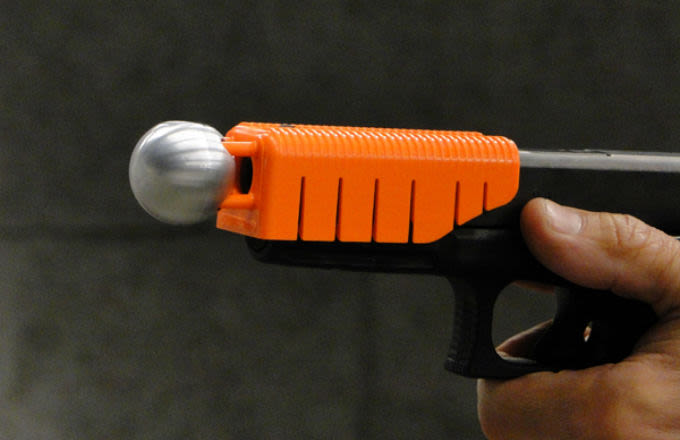 A Handgun Attachment Aims to Save Lives by Making Bullets Non-Lethal