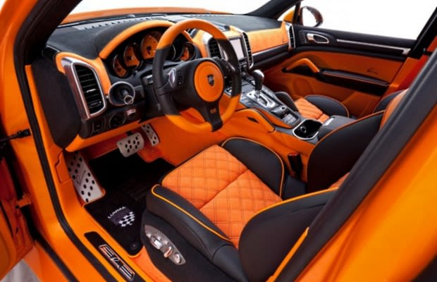 Porsche cayenne s hybrid the 50 most outrageous custom for Dash designs car interior shop
