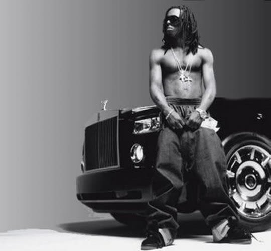 30 Photos Of Rappers Flexing With Giant Car