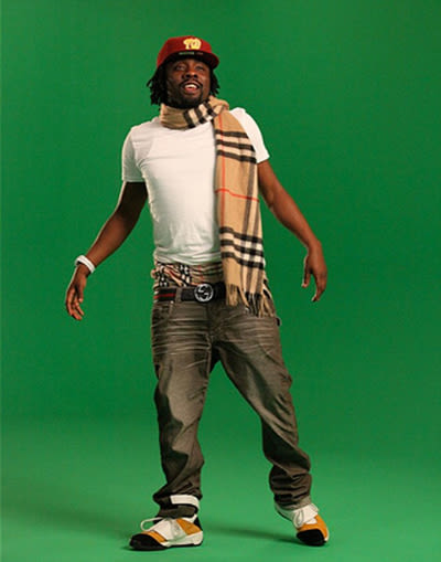 wale rocking a burberry scarf and boxers during a photo