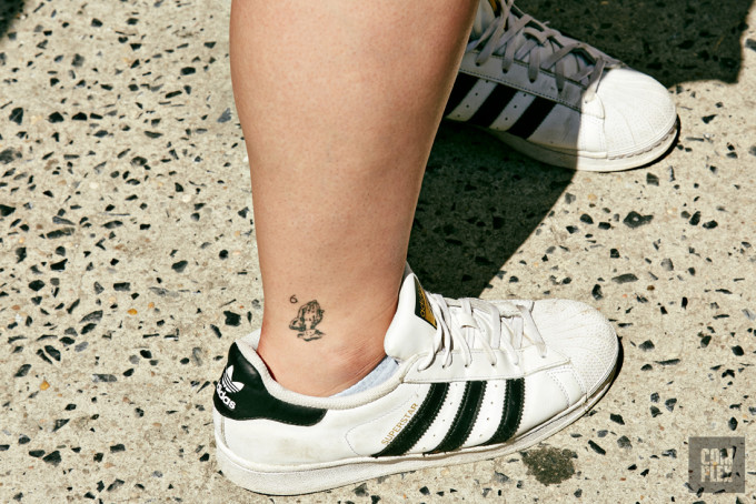 A fan shows off their Drake-inspired tattoo at the Summer Sixteen pop-up in New York.