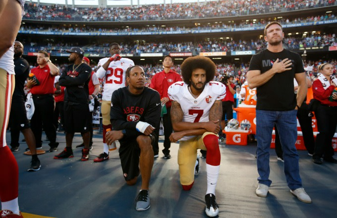 Colin Kaepernick kneels during the national anthem before a preseason game.
