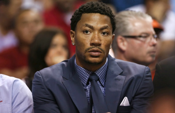 Derrick Rose sits on the bench.