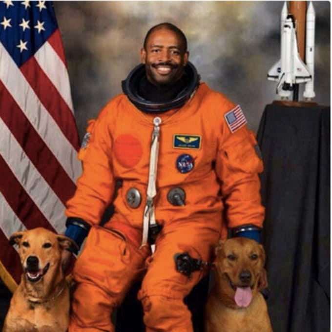 Ex-astronaut Leland Melvin with his dogs.