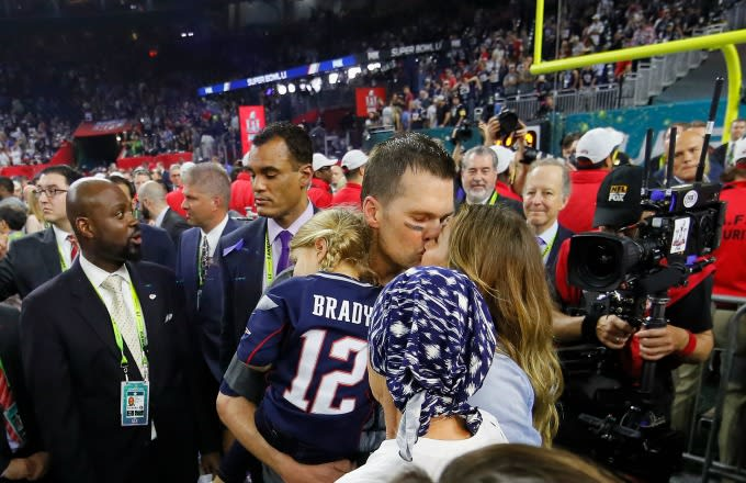 Tom Brady and Gisele Bundchen kiss after Super Bowl 51.