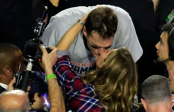 Tom Brady and Gisele Bundchen kiss after Super Bowl 49.