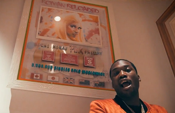 Meek Mill posing with the plaque from Nicki Minaj's 'Pink Friday: Roman Reloaded.'