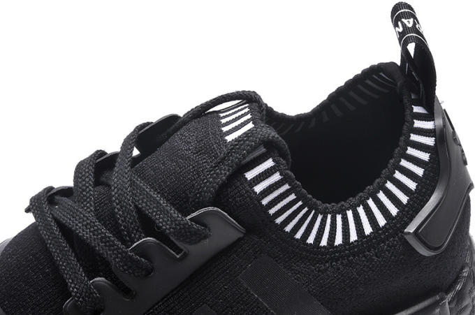 black nmds with chinese writing