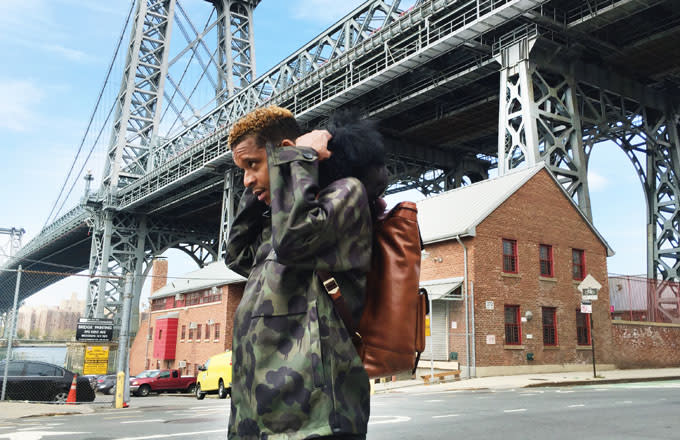 Roblé Ali A.K.A. Chef Roble wears the COACH Military Wild Beast Jacket and the Bleecker backpack in fawn underneath the Williamsburg bridge.