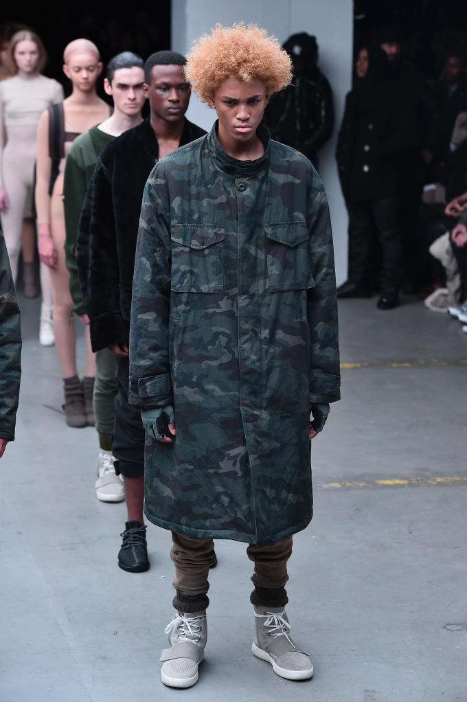 44d457b2e5aa2 ... camo jackets and surplus-inspired coats, while other notable pieces  included distressed military sweaters, slim sweatpants, and oversized knit  tops.