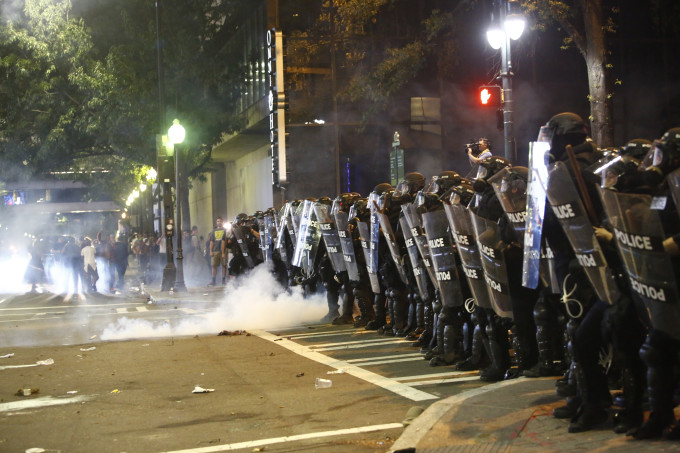 Police clash with protesters.